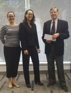 Rowan Meredith (centre) receives the VMAA Prize from CoRe president Jacqueline Fehr and VMAA director David Read.
